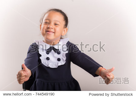 Adorable cute african child with afro hair showing a thumbs.