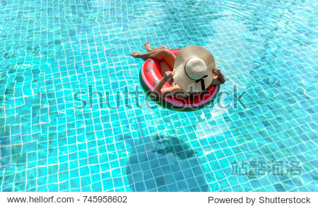 Woman bikini swimming pool on watermelon rubber ring relaxing vacation enjoying on summer season  Top view.