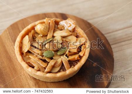 almond nuts pistachio walnut hazelnuts tart cake isolated on table