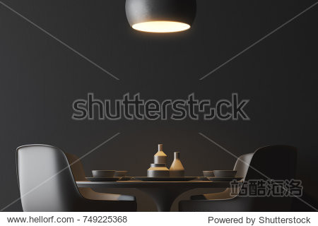 Black wall minimalistic dining room interior with a round black table and black chairs standing near it. A ceiling lamp. 3d rendering mock up