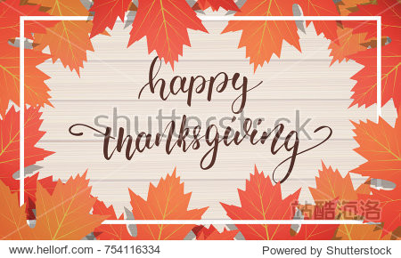 Thanksgiving Day. Hand lettering on the wooden background with trendy autumn foliage.