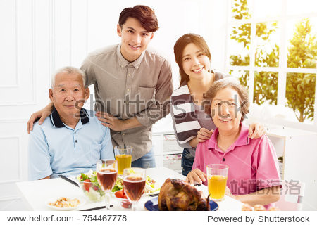 Happy family having dinner together