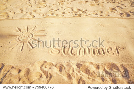 Drawing  picture of the sun  traces and word summer on golden sand on sunny sandy beach. The concept of beach recreation  summer vacation rest  pattern  texture of sand.