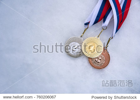 Gold silver and bronze medal  white snow background. Winter sport trophy for ski  hockey  nordic ski. Picture for winter olympic game in pyeongchang 2018