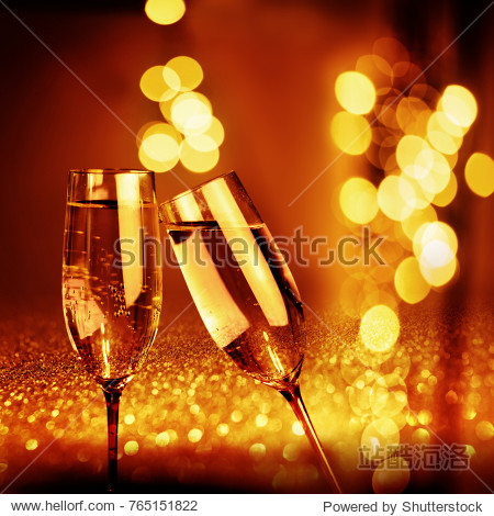 Abstract gold glowing bokeh background with champagne for new year congratulations