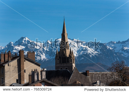 medium shot of The Collegiate Church of Saint-André  Grenoble and the Belledonne mountain range in the background