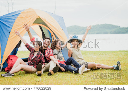Happy Asian friends having a good time together while travel camping vacation trip by the lake