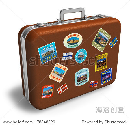 Brown leather travel suitcase with colorful labels isolated on white background