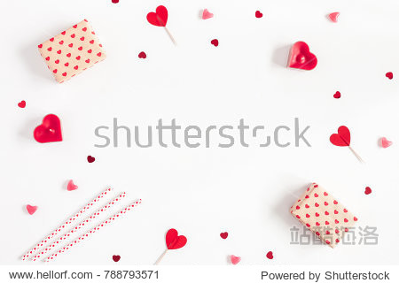 Valentine's Day. Frame made of gifts  candles  confetti on white background. Valentines day background. Flat lay  top view  copy space.