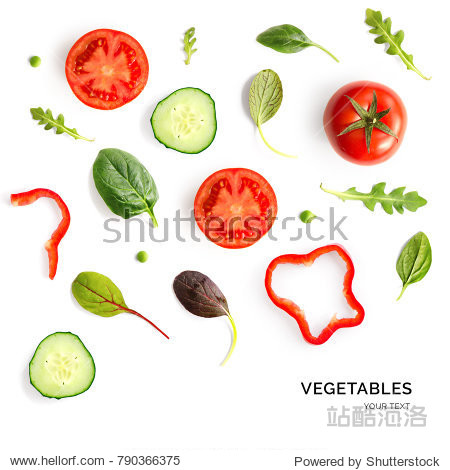 Creative layout made of tomato  cucumber and salad leaves. Flat lay. Food concept.