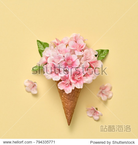Ice Cream Cone with Bouquet of Flowers. Spring Summer Floral concept. Creative Minimal. Pink Blossom  Vanilla Color. Trendy fashion Style. Art Vintage