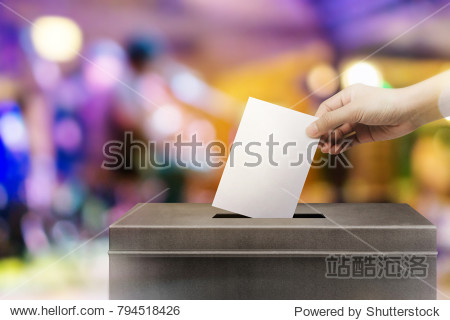 Colorful fo election vote  hand holding ballot paper for election vote concept at colorful background.