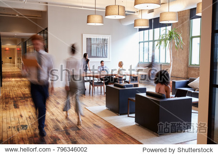 Business people at work in a busy luxury office space