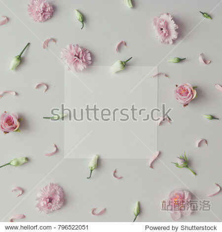 Creative pattern made of violet and pink flowers with paper card copy space. Flat lay. Minimal season background.