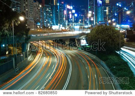 traffic at night in blur motion downtown - Causeway Bay, Hong Kong