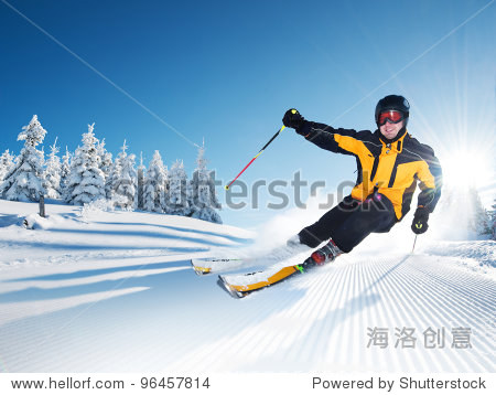 Skier in mountains  prepared piste and sunny day