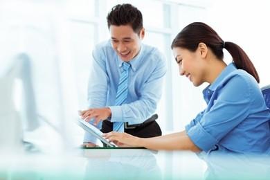 Vietnamese business team discussing financial document