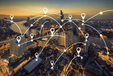 Map pin flat above bangkok cityscape and network connection concept