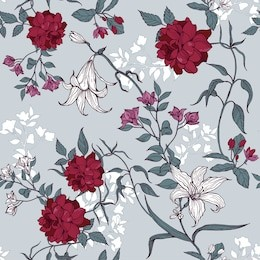Roses and lilies with leaves floral pattern on a blue background.
