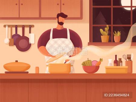 一个男人晚上在厨房煮饭做美味的晚餐