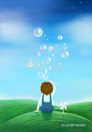 夏天在草地上吹泡泡的小男孩