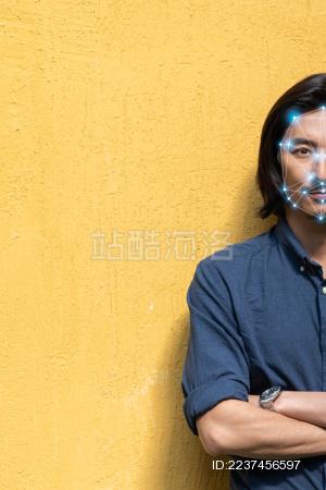 亚洲青年男士正面肖像照和人脸识别概念