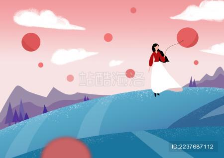 山坡上 女孩享受着微风 放飞气球瞭望